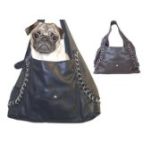 small dog in a purse carrier for pets