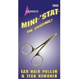 cleaning dogs ears - hemostat for dog ear grooming