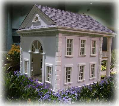 custom made dog house in a 2-storey southern style with upper balcony