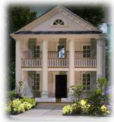 southern 2-story colonial style custom dog house with upper balcony