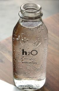 glass bottle of water marked H₂O