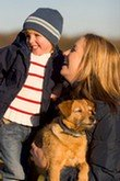 contact us, Mom with young child and cute dog